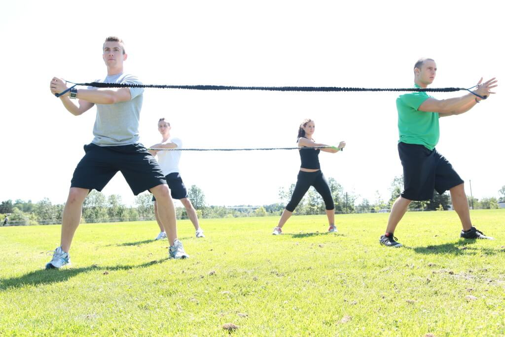 Flashback! My team and I demonstrating Core Rotation exercises using resistance bands a few years ago.